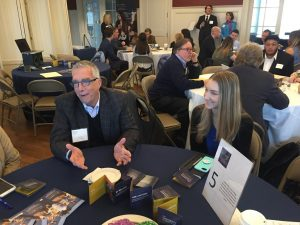 Students network with Harrington Board members