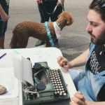 Photo of Nate Vaccaro at a typewriter.