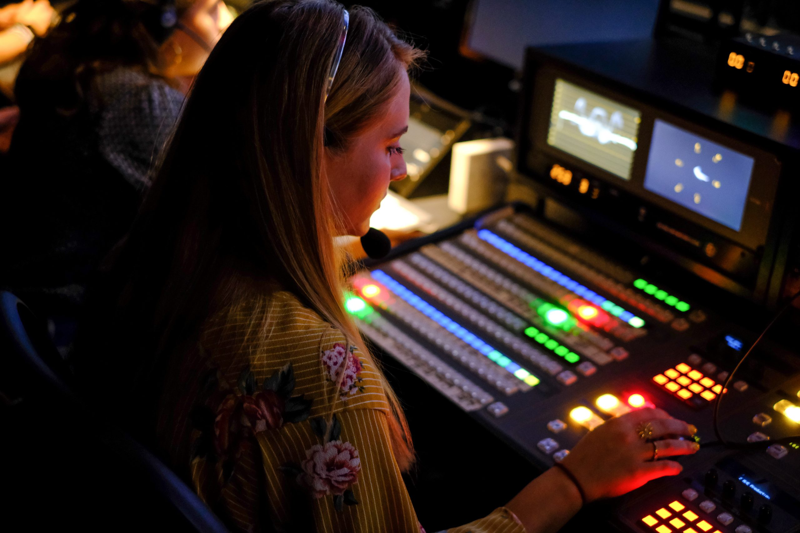 a student at the broadcast center board