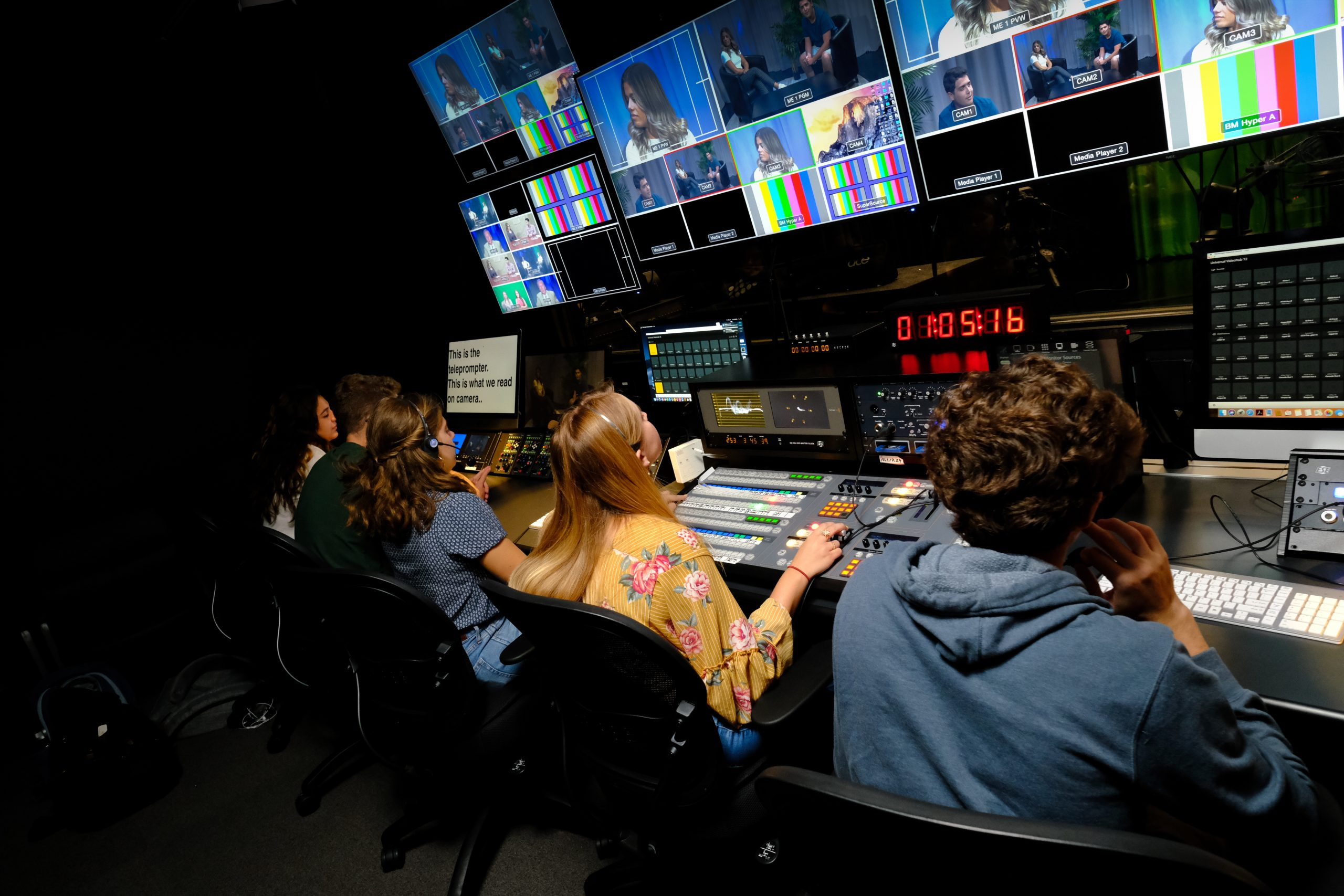 Students in the broadcast center control room